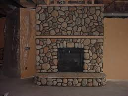 river rock fireplace by ancient art of stone