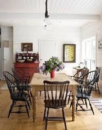scrubbed pine table and black chairs love the color of the table i would do a clic chair instead of a farm chair