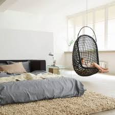 Black Wicker Hanging Chair With Brown Wool Rug For Contemporary Bedroom  Decorating Ideas