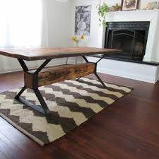 industrial trestle reclaimed wood dining table by peter gadjev