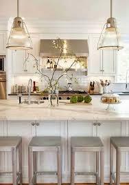 white kitchen lighting. Crisp White Kitchen With A Pair Of Glass Pendant Lignts Lighting S