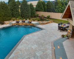 Patio with pool Florida Pool Patio With Pavers And Fire Bowl Fountains The Site Group All You Need To Know About Pool Patios Material Options Design