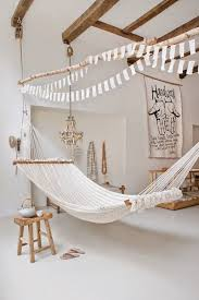 View in gallery Large hammock in white room with wood accents
