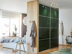 Superior A Large Bedroom With A Green Wardrobe To Divide The Space