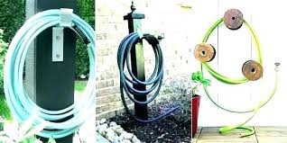 decorative garden hose holder wall mount container storage ho outdoor bunnings
