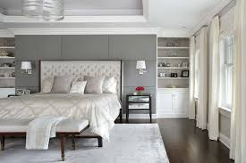 master bedroom cream headboard built in wall shelving