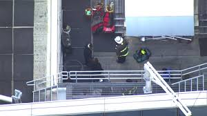 Firefighters rescue window washers stuck 10 stories on high-rise ...