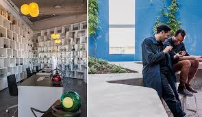 omer arbel office seating. left bookcases filled with glassblowing experiments double as room dividers a pair omer arbel office seating