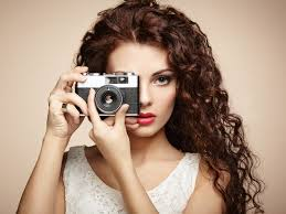 Portrait of beautiful woman with the camera. Girl photographer by.