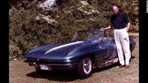 the father of the iconic corvette general motors car designer harley earl stands next