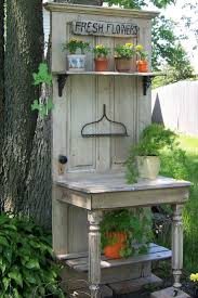 garden ideas my husband a friend constructed this from an old door half a table and