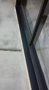 after rotted patio door track replaced with a new bronze aluminum track