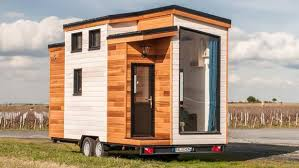 tiny houses. the utopia consists of a spruce frame atop double-axle trailer. tiny houses