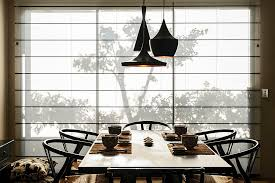 ... Tom Dixon pendants and stylish midcentury chairs are perfect for the modern  Asian dining space [