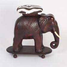 impressive anglo indian elephant bench or seat carved from a single block of mahogany presented