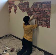 applying brick faux wallpaper to plaster wall for an old world faux finish