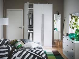 ikea bedroom furniture wardrobes. a bedroom with white pax vinterbro wardrobe stainless steel handles nordli chest and bed ikea furniture wardrobes