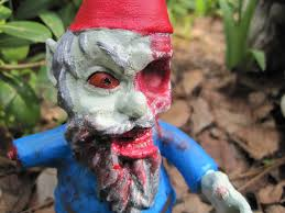 los angeles based couple chris stever and jane derosa have created a collection of zombie gnomes garden gnome statues where each gnome has bee a gory