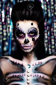 woman with makeup on colorful bokeh background glamor skeleton make up stock photo