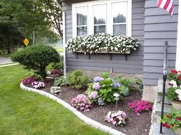 1. Cheerful Floral Border and Window Boxes
