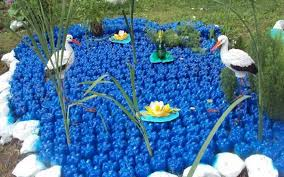 Decorated Plastic Bottles Plastic bottles crafts Ideas to reuse as garden decorations 61