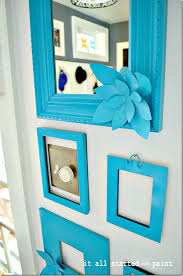 blank picture frames painted turquoise on wall brighter