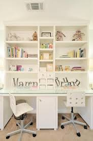 shared girls room features a built in white desk boasting a glass top and seating