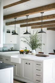 lighting above kitchen island. rustic beams and pendant lights over a large kitchen island lighting above