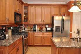 medium oak kitchen cabinets. Modular Honey Oak Kitchen Cabinet With Granite Countertop And Black Built In Wall Microwave Also Refrigerator Water Ice Dispenser Medium Cabinets D