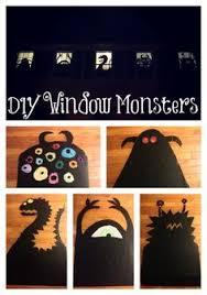 love halloween window decor: window monsters  window monsters