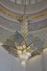 there are a lot of chandeliers in the mosque and one of which is the second largest in the world inside the mosque
