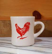 Look his business up on the web at www.eyegraphics.ie. Red Rooster Coffee Mugs Red Rooster Cookbooks