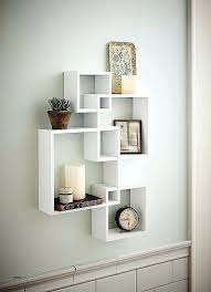 3 tier wall shelves 3 tier wall shelves lovely shelving solution intersecting decorative white color wall