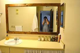 bathroom mirror. framing a bathroom mirror with pallets from rachel schultz