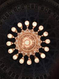 inside the main mosque hangs the second largest chandelier in the world and one of the largest oriental carpets