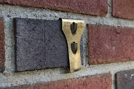 to hang art on brick or stone
