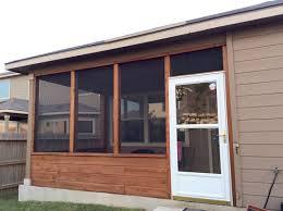 cedar screened porch with glass storm door