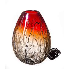 striking hand n glass lamp in red and black
