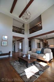 light and living lighting. open plan living room with faux beachwood beams and wire orbital chandelier hanging light fixtureshanging lightsfaux lighting