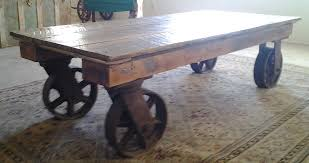Industrial Glass Coffee Table Industrial Coffee Table On Wheels Rustic Wooden Material Clear