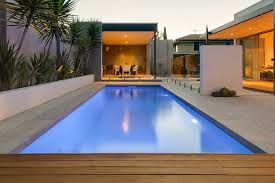 a well designed backyard complete with a fibreglass swimming pool and entertaining area