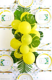 diy balloon fronds tropical party centerpiece birdsparty com