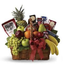 orted seasonal fresh fruit and gourmet food items in a basket