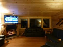 living room with wood not gas fireplace 55 tv 3 couches