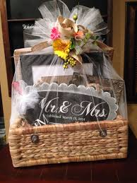 wedding gift basket filed with personalized gifts made with my silhouette wrapped with tulle and burlap flower ribbon i love a pretty present
