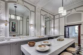 a well placed mirror can create a sense of space in what is usually one of the smallest rooms in the house while turning the c of
