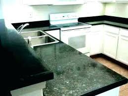 countertops that look like granite painting vs quartz heat resistance