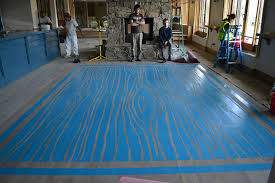 wood grain faux rug painted on wooden floor 16 ft x 20 ft wildwood hotel lobby bar snowmass village co