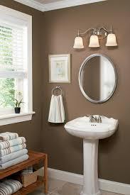 cool bathroom lights over mirror creating the best bathroom lighting