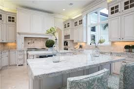 granite countertop ideas for white cabinets. luxury kitchen with white cabinetry, giallo fantasia granite counter, center island, dining island countertop ideas for cabinets s